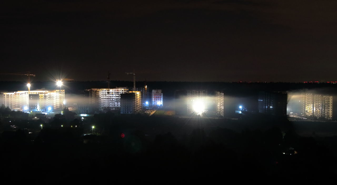 VIEW OF ILLUMINATED BUILDINGS AT NIGHT
