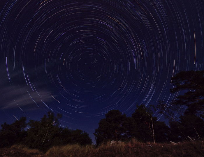 Polaris after Lunar Eclipse - Star trails taken after the blood moon has vanished. Polaris Astronomy Dark Blue Long Exposure Motion Nature Night No People Sky Space Spinning Star Star - Space Star Trail Swirrel Edge