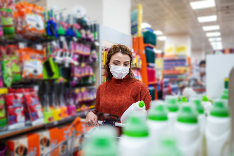 Woman wearing mask shopping at mall