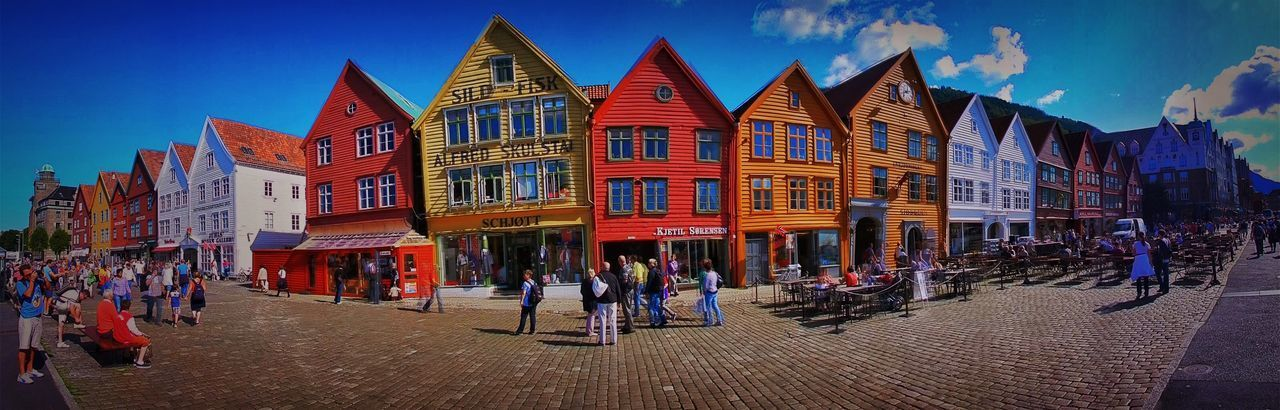 Bergen Houses Norway Architecture Building Building Exterior Built Structure City City Life Day Footpath Group Of People Housefront Illuminated Nature Outdoors Panoramic People Real People Sky Street Travel Destinations Walking