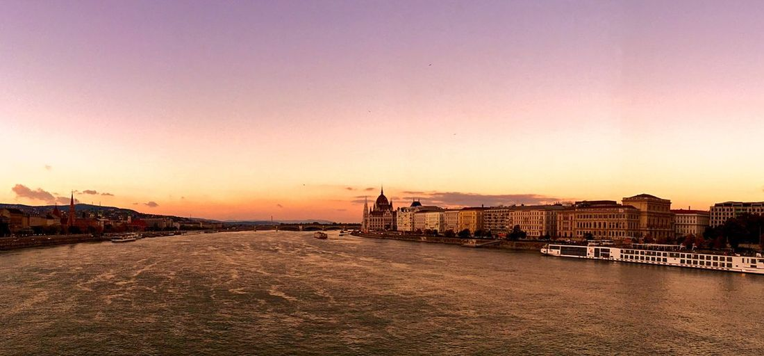 High angle view of Danube River by Hungarian Parliament Building at sunset