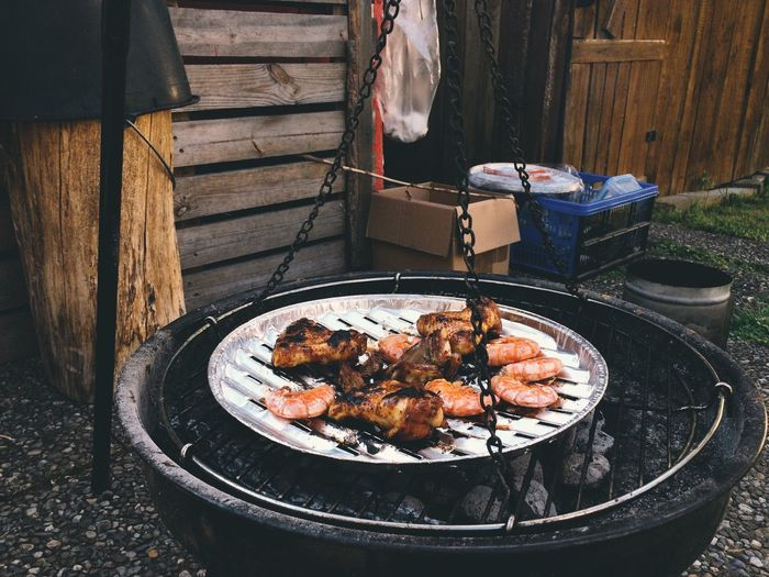 Meat Cooking On Barbecue Grill In Yard