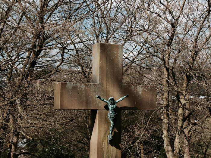 Crucifix against bare trees