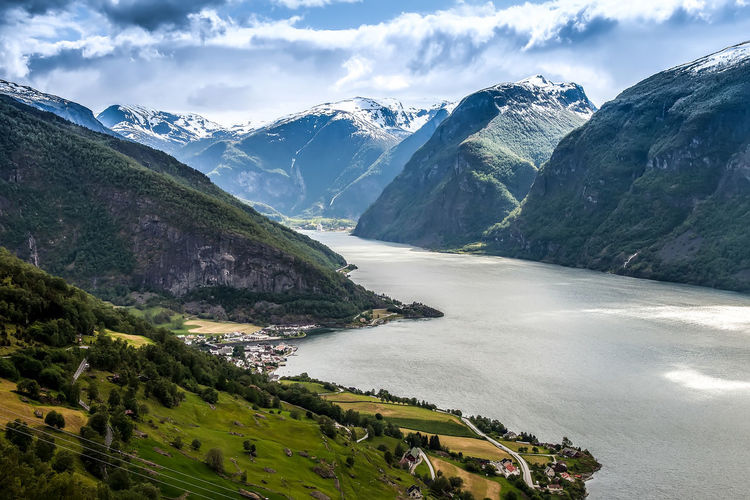 Aurlandsfjord in norway Aurlandsfjord Holiday Norway Travel Beauty In Nature Cloud - Sky Clouds And Sky Day Grass Landscape Landscapes Mountain Mountain Range Mountains Nature No People Outdoors River Scenics Sky Tranquil Scene Tranquility Tree Water