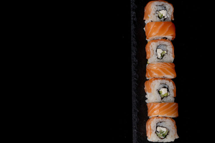 High angle view of sushi against black background