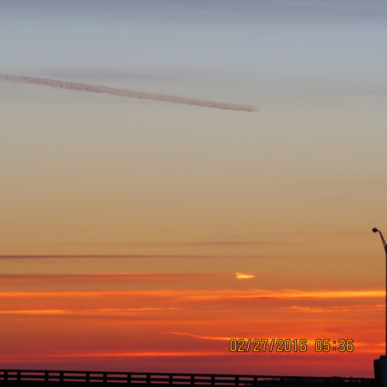 sunset, sky, transportation, communication, air vehicle, airplane, scenics, sea, flying, no people, beauty in nature, outdoors, nature, water, vapor trail, day