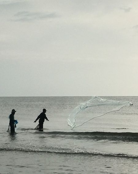 Fisherman Friend Sea Water Horizon Over Water Nature Real People Beach Scenics Beauty In Nature Two People Sky Men Sand Standing Outdoors Full Length Day People