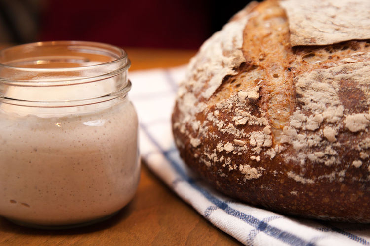 sourdough starter and loaf Bread Breakfast Brown Bread Close-up Day Fermentation Food Food And Drink Freshness Healthy Eating Home Baking Indoors  Loaf Of Bread No People Ready-to-eat Sourdough Sourdough Bread Starter Table Wheat