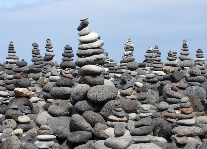 stacked rocks in tenerife Rock Pile Arrangement Balance Beauty In Nature Close-up Day Large Group Of Objects Nature No People Outdoors Pebble Pebbles Rocks Sky Stack