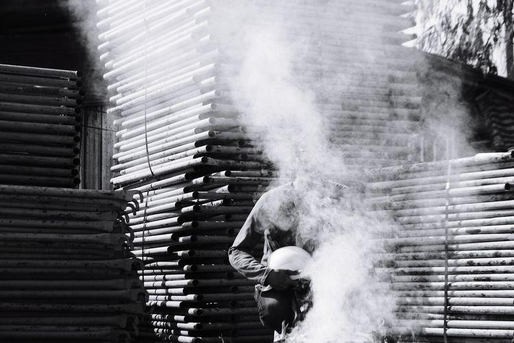 Man standing amidst smoke