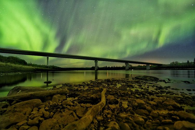 Bridge - Man Made Structure Connection Water Bridge - Man Made Structure River Built Structure Scenics Tranquil Scene Night Architecture Tranquility Low Angle View Sky Beauty In Nature Majestic Green Color Idyllic Illuminated Bridge Nature Architectural Column Aurora Borealis Aurora Aurora Chasing Northern Lights