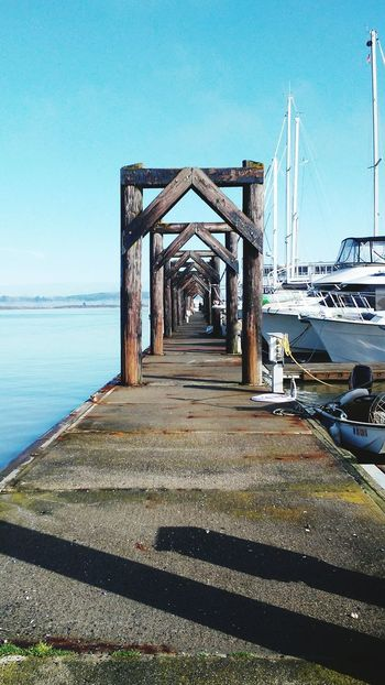 Boats And Water Sailboats Marina Dock Arch Architectural Detail Marina Walk Calm Calm Water Clear Sky No People Tranquility Tranquil Scene Outdoors Boats And Port Sailing Ship Black & White Photography Ocean View