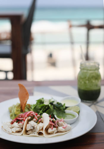 Beach Close-up Day Fish Fish Tacos Focus On Foreground Food Food And Drink Freshness Healthy Eating Indoors  No People Plate Ready-to-eat Sea Serving Size Table