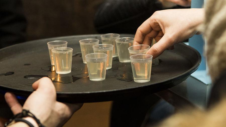 Cropped image of bartender serving drinks