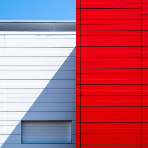 Blueskybuildingdetail Architecture Blue Built Structure No People Fujix_berlin Ralfpollack_fotografie Minimalism Minimal Red Pattern Building Exterior Building Backgrounds Wall - Building Feature City Outdoors Full Frame Modern Shadows & Lights 17.62°