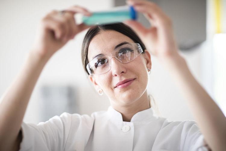 Portrait of mature man holding eyeglasses