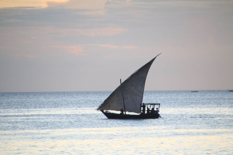 Sail fishing boat in Zanzibar Day Dhow Fishing Boat Horizon Over Water Nature Nautical Vessel No People Outdoors Sailboat Sea Sky Sunset Sunset Silhouettes Transportation Water Canon 70d