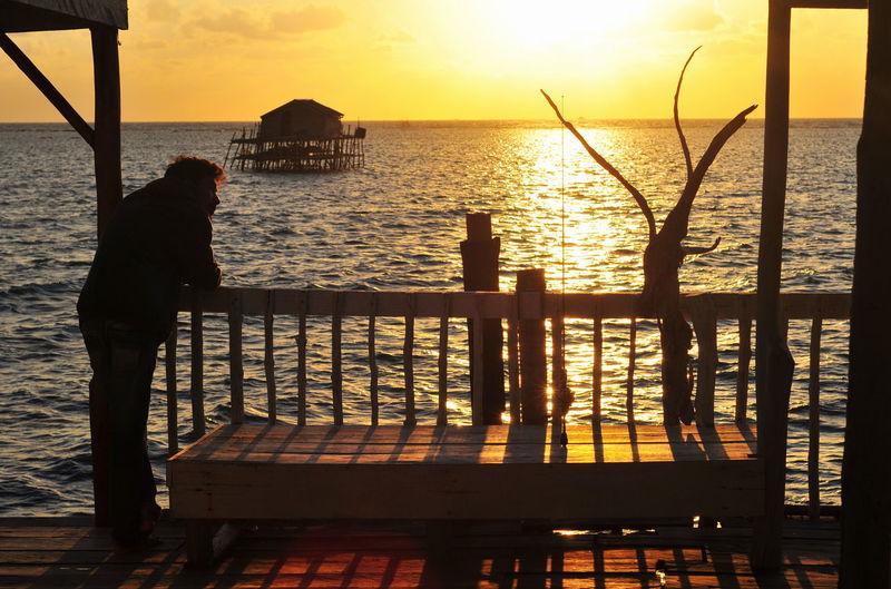 Sunrise Summer Sunrise_sunsets_aroundworld EyeEm Selects EyeEmBestPics Mood Orange Warm Illustration Silhouette Water Sea Tree Beach Sunlight Summer Silhouette Sun Sky Seascape Boat Fishing Horizon Over Water