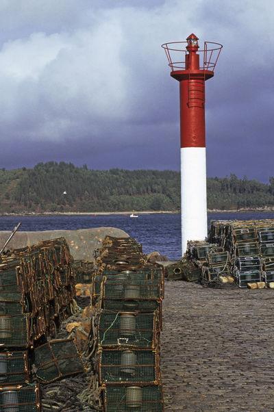 lighthouse and shellfish traps in Camarinas, Galicia, Spain Camariñas Cloud - Sky Clouds And Sky Cloudy Coast Fish Traps Fishing Equipment Fishing Net Galicia Lighthouse Lighthouse No People Sea Shellfish Traps SPAIN Vertical
