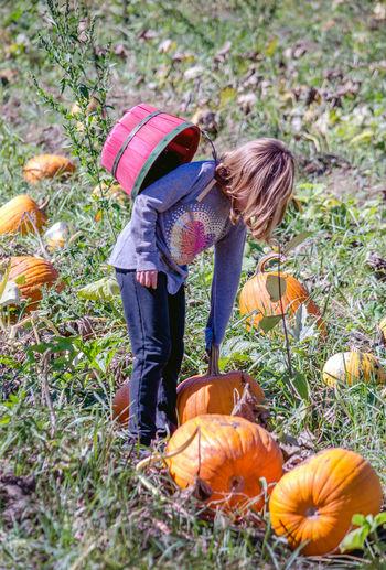 Full length of girl standing on field during autumn