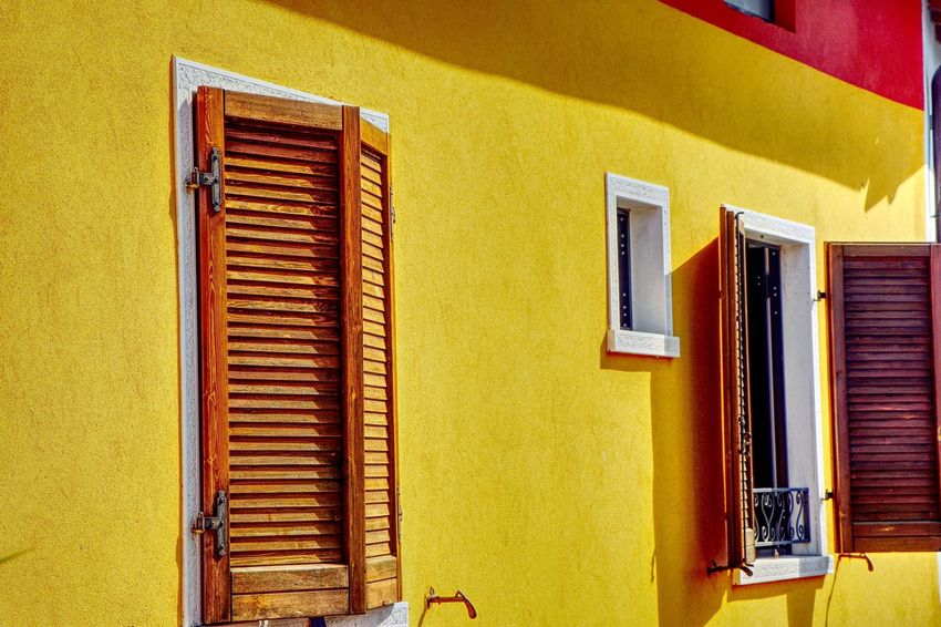 Yellow Building Exterior Architecture Window Built Structure Yellow Shutter No People Day Outdoors Yellow Color Yellow House Architecture Shutter Shutters Paint The Town Yellow