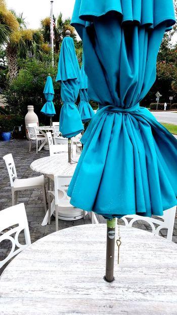 EyeEm Selects Ocean Blue Umbrellas. Color Photography Aqua Blue Color Full Frame Summer Hilton Head Hilton Head Island SC Beach Outdoors Colignyplaza Coligny Umbrella Closed Umbrellas Closed Umbrella Cafe Tables Chairs Restaurant Marble Eat