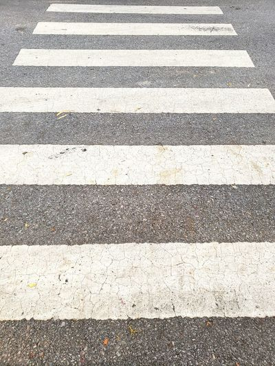Crosswalk. Backgrounds Textured  Street Streetphotography Street Photography Road Cross Crosswalk Crosswalking Crosswalks Roadways White Textured  LINE Crossing High Street Contrail Detail White Line Pedestrian Crossing Sign Architectural Design