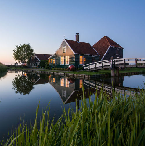 Traditional Dutch village Architecture Beauty In Nature Blue Building Exterior Built Structure Clear Sky Day Grass Growth Lake Nature No People Outdoors Plant Reflection River Scenics Sky Standing Water Tranquil Scene Tranquility Water