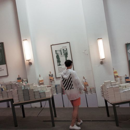 Real People Indoors  Rear View One Person Full Length Lifestyles Leisure Activity Standing Table Chair Day Architecture Young Adult People oblique