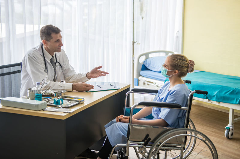 Doctor discussing with patient in hospital