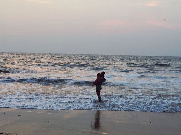 Playful with nature - Tides of joy. Sea Beach Fun Water Sand Nature Sunset Vacations Outdoors Kid Father And Son Playful