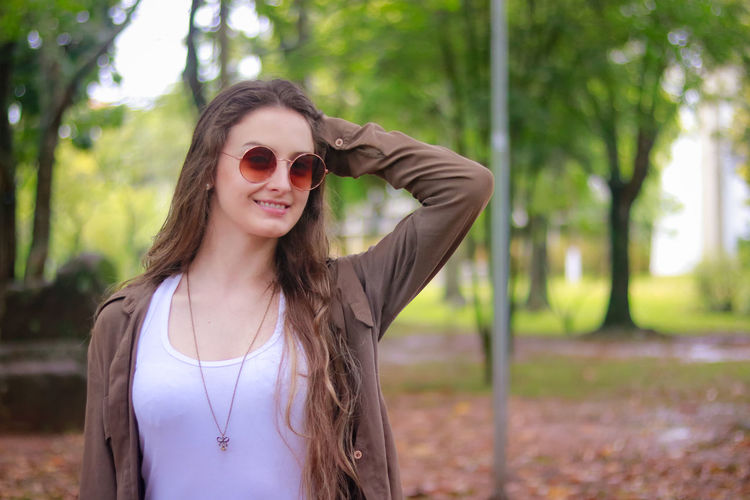 Beautiful Woman Day Focus On Foreground Front View Happiness Long Hair Nature One Person Outdoors Portrait Real People Smiling Sunglasses Tree Young Adult Young Women