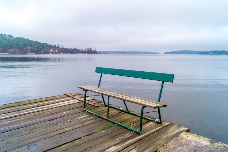 Bench on wooden pier