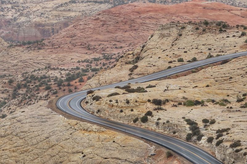 High angle landscape of road leading through white and pink horizontal bare rock Grand Staircase Escalante National Monument, Utah High Angle View Nature Day Environment Landscape Road Land No People Scenics - Nature Transportation Mountain Curve Outdoors Tranquility Beauty In Nature Direction Tranquil Scene Pattern Travel Mountain Road The Great Outdoors - 2018 EyeEm Awards