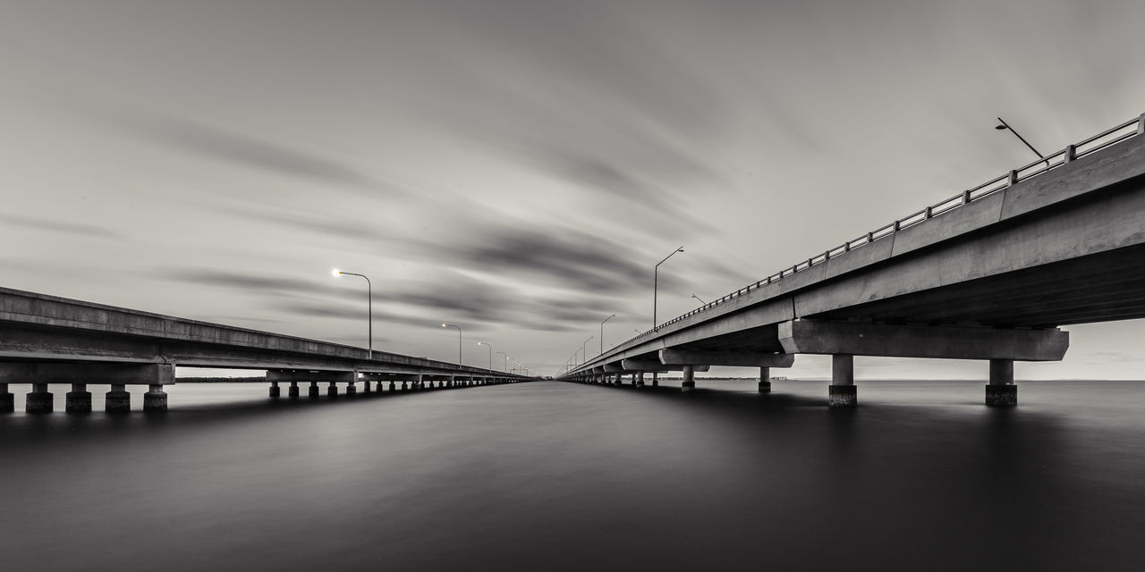Art Wall Art Black & White Bridges Fine Art Photography Architectural Column Black And White Blackandwhite Bridge Bridge - Man Made Structure Built Structure Cloud - Sky Clouds And Sky Connection Day Engineering Fine Art Fineart Low Angle View River Sky Transportation Underneath