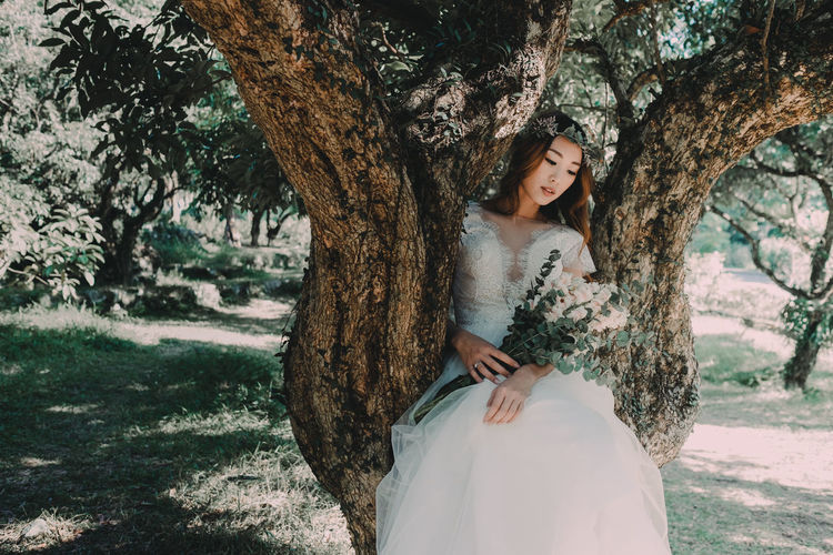 Adult Adults Only Beautiful People Beauty Beauty In Nature Bride Charming Day Nature One Person Only Women Outdoors People Portrait Tree Wedding Wedding Dress Young Adult