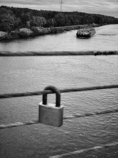 Padlocks on bridge over river