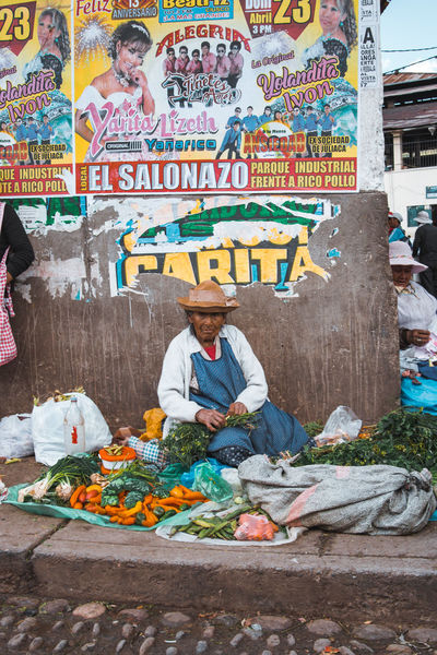 Exploring the street market just south of the San Pedro Market. Andes Backpacking City Cityscape Exploring Inca Latin America Adult Casual Clothing Colonial Day Discover  Front View Market Multi Colored One Person Outdoors Real People Retail  Sitting Small Business South America Text Travel Destinations Urban The Traveler - 2018 EyeEm Awards The Portraitist - 2018 EyeEm Awards The Street Photographer - 2018 EyeEm Awards