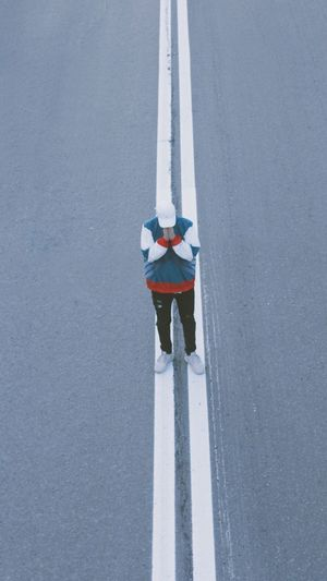 High angle view of person standing on road in winter