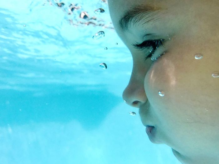 Close-up of girl swimming in water