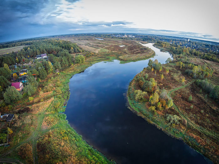 The village on the banks of the river Mologa. One of the many villages Maksatihinsky district of Tver region. Aerial Shot Aerial View Beauty In Nature Cityscape Cloud - Sky Countryside Drone  Dronephotography Landscape Mologa Nature No People Outdoors Reflection River Rural Scene Scenics Sky Tourism Travel Destinations Village Water