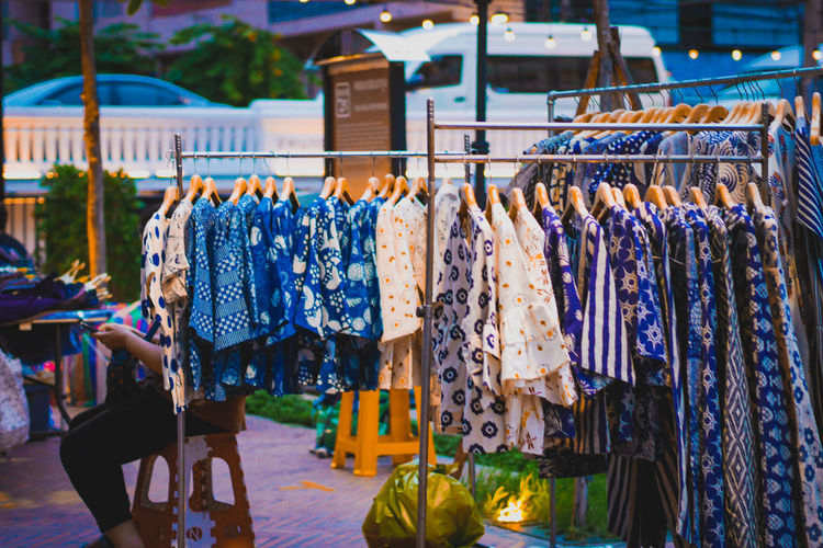 Clothes hanging in market stall for sale