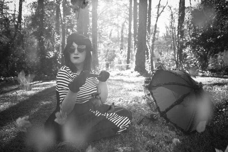 Beautiful Woman Blackandwhite Casual Clothing Day Fall Forest Front View Full Length Leaves Leisure Activity Lifestyles Nature One Person Outdoors People Portrait Portrait Of A Woman Real People Relaxation Sitting Tree Tree Trunk Young Adult Young Women