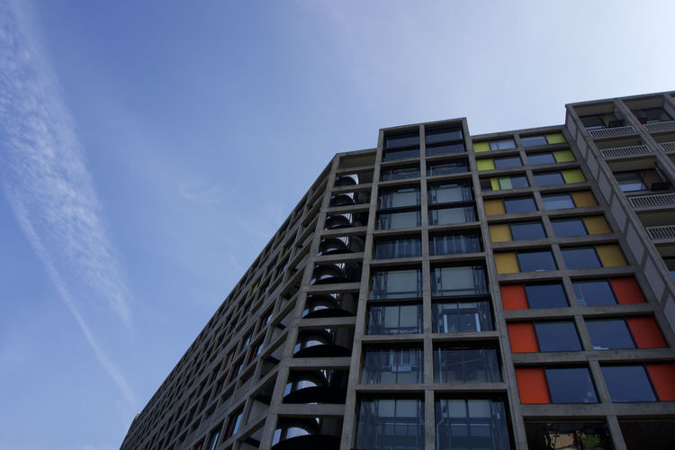 Low angle view of new flats at Park Hill in Sheffield Sheffield Built Structure Architecture Building Exterior Sky Low Angle View Building Nature No People Modern Window City Day Outdoors Office Office Building Exterior Tall - High Skyscraper Cloud - Sky Residential District Blue Sunlight