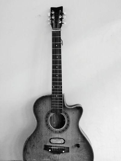 Guitar against wall