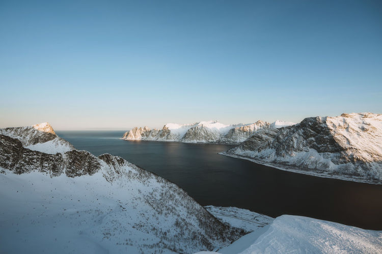 frozen peaks of Senja. Check out my prints at https://simonmigaj.com/shop/ and visit my IG http://www.instagram.com/simonmigaj for more inspirational photography from around the world. Norway Norge Mountains Mountaineering Extreme Weather Travel Adventure Senja  Fjord Water Ocean Blue View Background Clear Sky Water Blue Sunset Winter Sky Landscape Snowcapped Mountain Snow Horizon Over Water Deep Snow Cold Temperature Powder Snow Cold Snowcapped Mountain Range