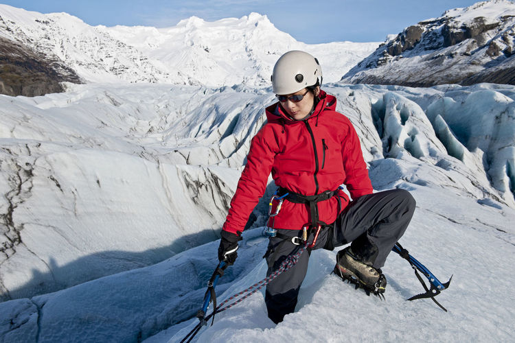 Full length of person in snow against mountain range