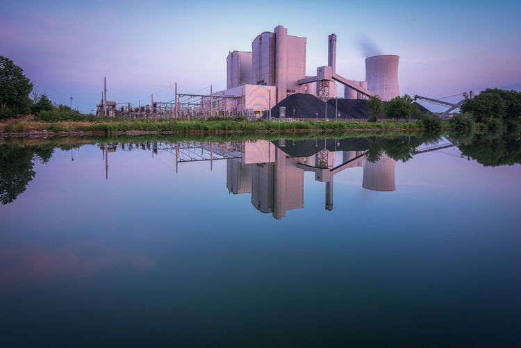 Power plant in Stöcken, Hannover during an evening in summer Reflection Water Waterfront Architecture Built Structure Building Exterior Sky Building No People Symmetry Day Industry Outdoors Factory Tranquility Cloud - Sky Power Plant Industry Architecture EyeEmNewHere Calm Water Long Exposure Electical Power Canal Hannover