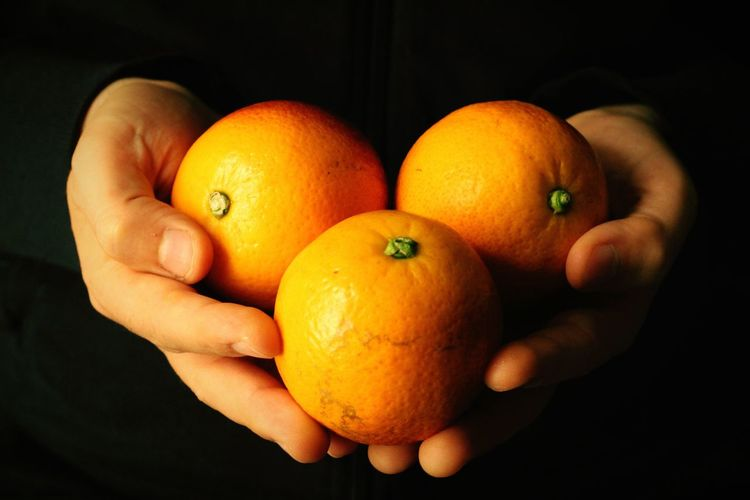 Human Hand Black Background Healthy Lifestyle Fruit Citrus Fruit Agriculture Holding Close-up Food And Drink Tangerine Vitamin C Orange Tree Orange - Fruit Blood Orange Sour Taste Vitamin Juicer