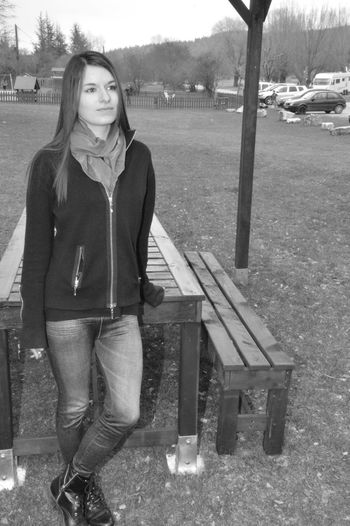 Portrait of young woman sitting on bench